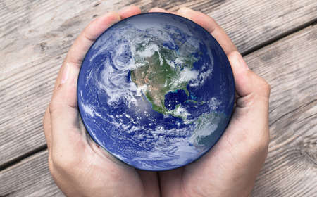 holding globe: Man holding globe in hands  Stock Photo
