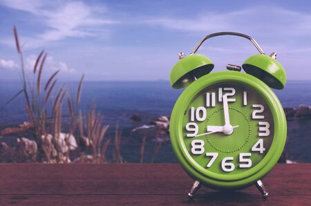 hillock: Clock on Wooden Floor with Blue Sky and Hillock  Background , Vintage Style