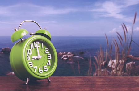 hillock: Clock on Wooden Floor with Blue Sky and Hillock  Background