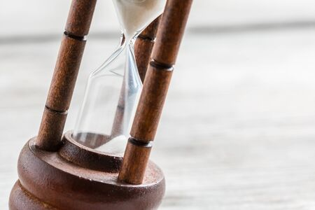 ancient pass: Close-up Hourglass on wood background Stock Photo
