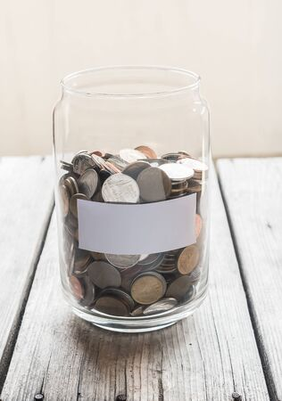 money jar: Money jar with coins on wood table , Saving Concept
