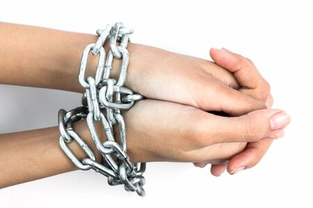 Women hands chained isolated on white background