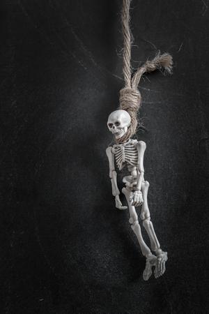 hanged: Hanged skelenton over black backbround