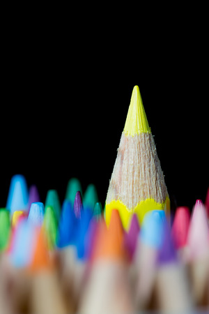 Yellow color pencil stands out among many color pencils , selective focus Banco de Imagens