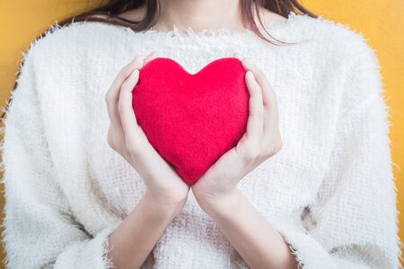 love shape: Woman hold Love symbol red heart - people, relationship and love concept