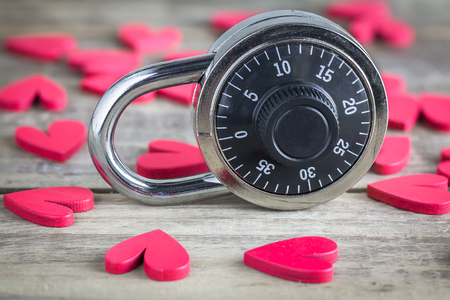 Combination padlock stands on amongst the hearts