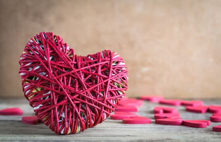 i hope: Red heart yarn with red heart shape on wood table over brown wood background