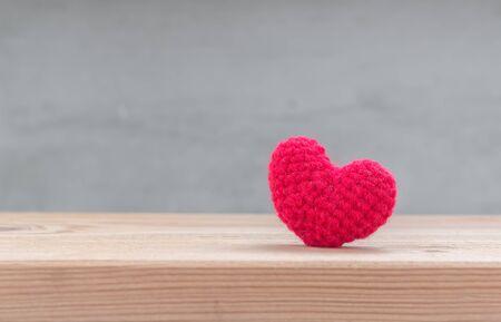 i love u: Red heart shape silk on wood table