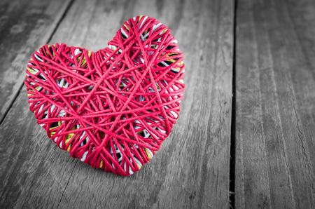 i love u: Read heart yarn on grunge wood table