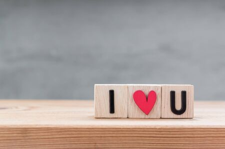 i love u: I love you in wooden cube on wood table