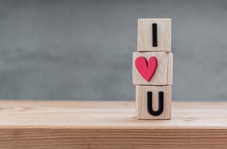 i love you sign: I love you in wooden cube on wood table