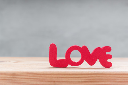 i hope: Words Love from wooden on wooden over grung cement background
