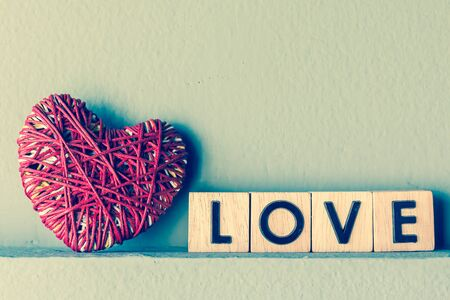 i hope: Red heart yarn with love in cube , vintage tone Stock Photo