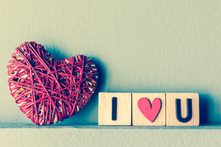 i love you sign: Red heart yarn with i love u in cube , vintage tone Stock Photo
