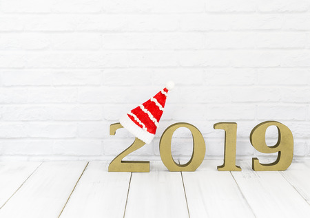 2019 new year and christmas hat on white wood table over white background with copy space