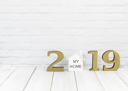 2019 new year and home  on white wood table over white background with copy space , Real estate concept Stock Photo