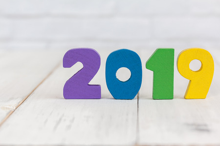 2019 new year on white wood table with copy space