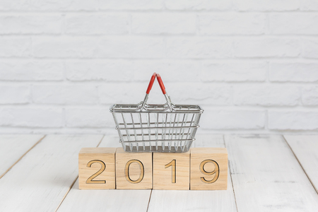 basket on 2019 new year block ,  shopping concept