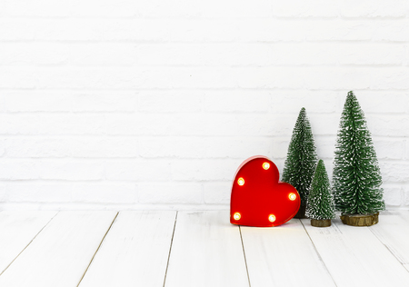 heart and christmas tree on white wood table over white background with copy space , love concept Stock Photo