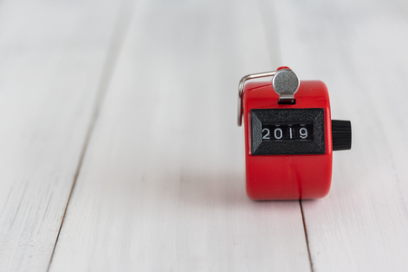 Red Hand tally counter with 2019 new year with copy space