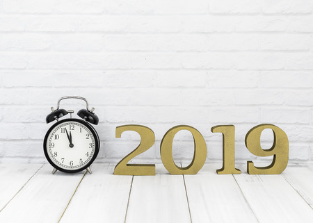 2019 new year & alarm clock on white wood table over white background with copy space , time concept