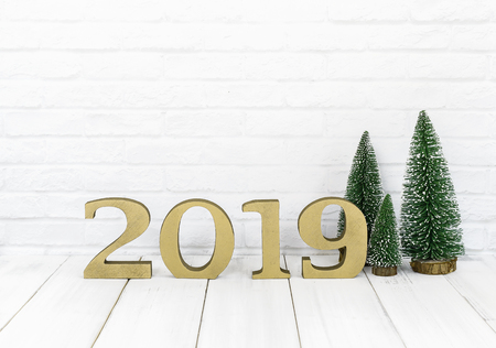 2019 new year and christmas tree on white wood table over white background with copy space