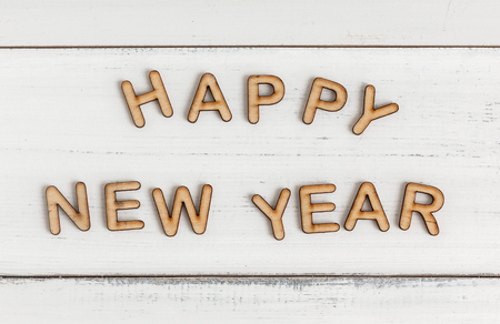 Happy New Year from alphabet letters on wood table Stock Photo