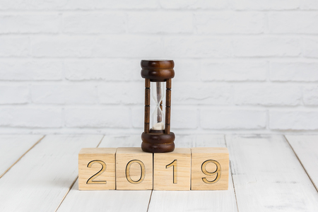 hour glass on 2019 new year block ,  time concept