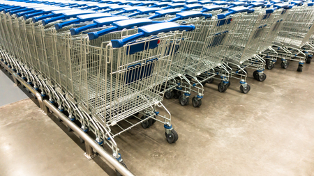 Rows of shopping carts on supermarket