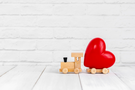 Red heart shaped on wood train over white background with copy space Stock fotó