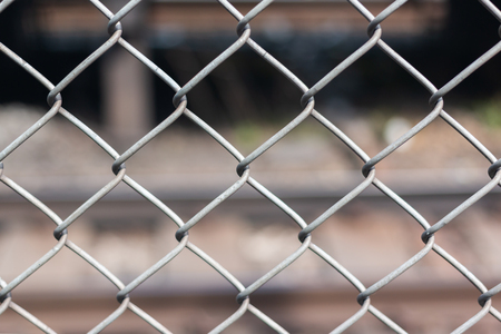 steel wire net fence with blurred background