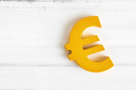 Euro sign on white wood table with copy space. Stock fotó