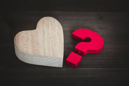 Wooden heart with Red Question mark , Problem concept Stock fotó