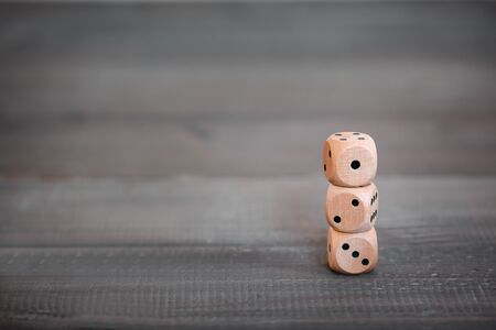 Stack of Wooden Dice on wood table
