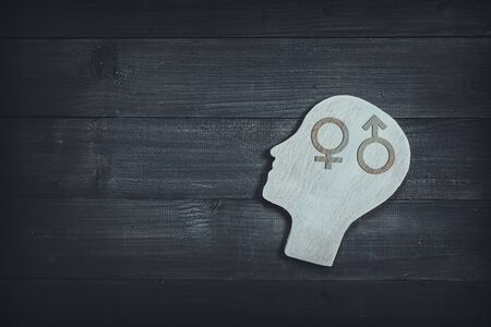 Human head and face with male and female  sign  on wood table background. Brain of thinking about gender , Symbol of Process and Positive Mind concept