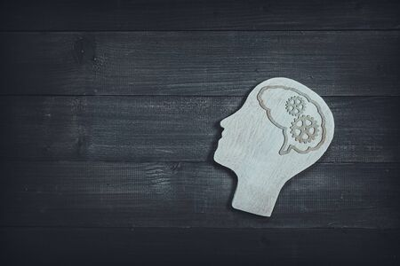 Human head and face with gear sign  on wood table background. Brain of thinking about driving the organization , Symbol of Process and Positive Mind concept Stock fotó