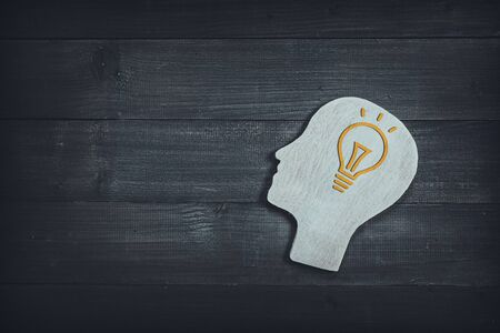 Human head and face with light bulb sign  on wood table background. Brain of thinking about ideas and creative , Symbol of Process and Positive Mind concept Stock fotó