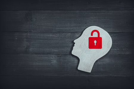 Human head and face with red lock on wood table background. Brain of thinking about safety , Symbol of Process and Positive Mind concept Stock fotó