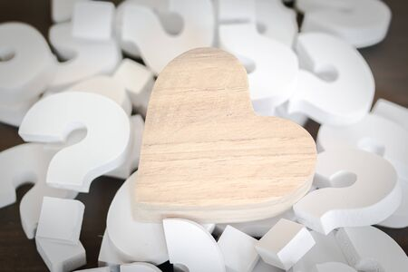 Wooden Heart over group of White Question mark , Problem concept Stock fotó