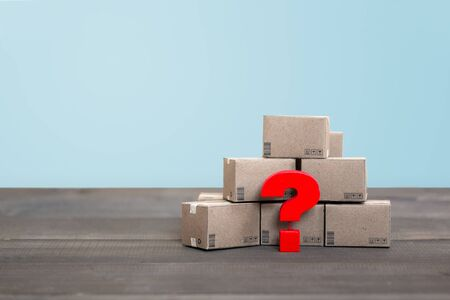 Shipping Box with Question mark on wood table , Problem concept Stock fotó