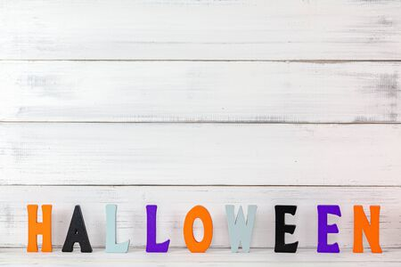 Halloween letters over white wood background. Stock fotó