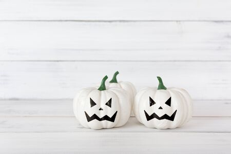 White ghost pumpkin on white wood table with copy space.