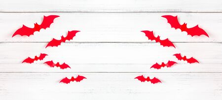Halloween red bats flying horror on white wood background, decoration concept. Stock fotó