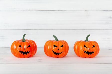 Orange ghost pumpkin on white wood table with copy space ,  halloween concept. Stock Photo