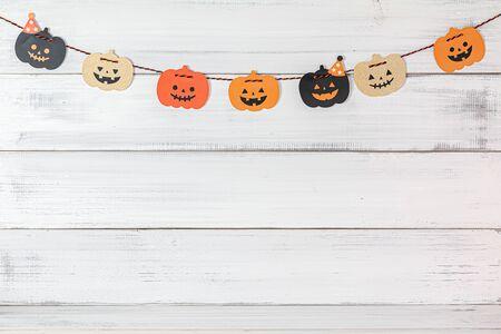 Halloween pumpkins decoration over white wood background.
