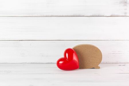 Red Heart with Wooden Blank Speech Bubble on white wood background. Communication of Love concept with Copy Space. Stock fotó