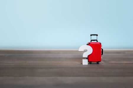 Question mark with Red Luggage Bag on wood table , Problem Concept Stock fotó