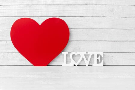 Red Heart Shaped with Love Alphabet on white wood over white wood background Standard-Bild