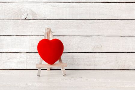 Red Heart with wood art stand on white wood Background