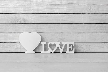 White Heart Shaped with Love Alphabet on white wood over white wood background
